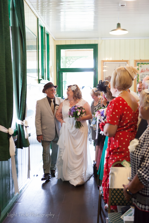 bride walking down the isle in waiting room platform 1 Horstead Keynes station