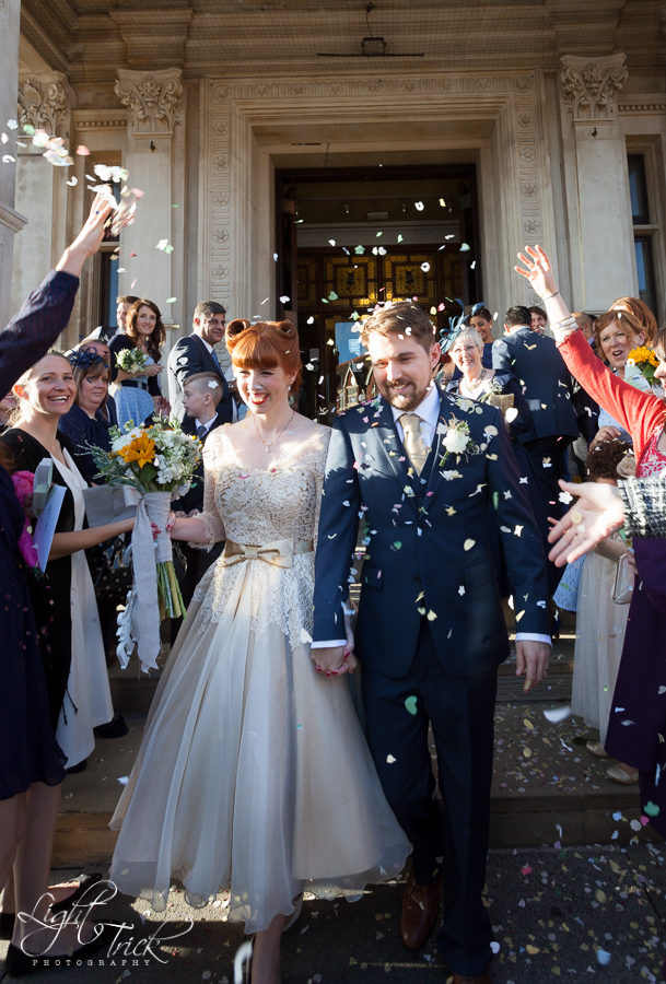 Throwing confetti at Eastbourne town hall entrance