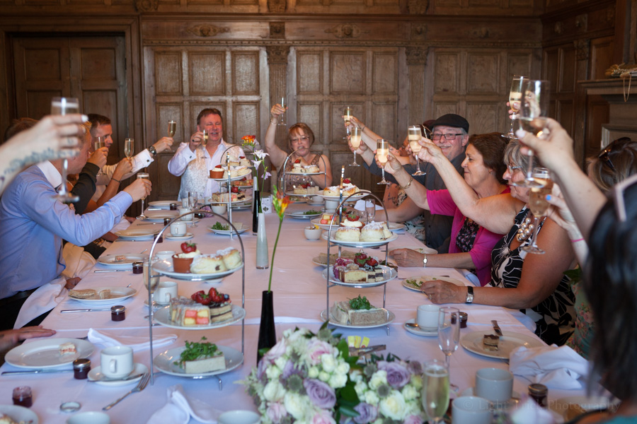 Wedding guests toasting the couple at Pelham House