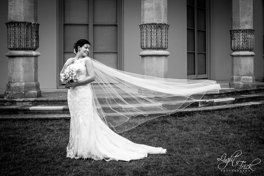 bride with a long veil in front of Royal Pavilion, Brighton