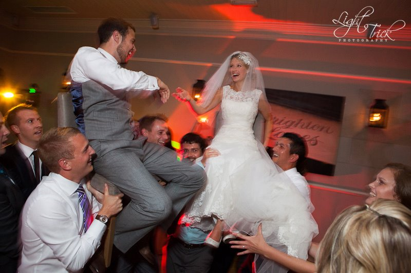 bride and groom lifted in a chair Jewish wedding tradition