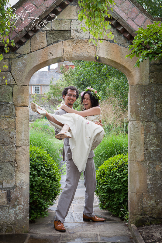 fun wedding couple in the southover grange garden in Lewes