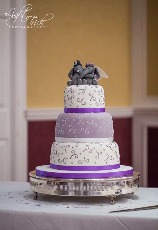 wedding cake with elephant cake toppers