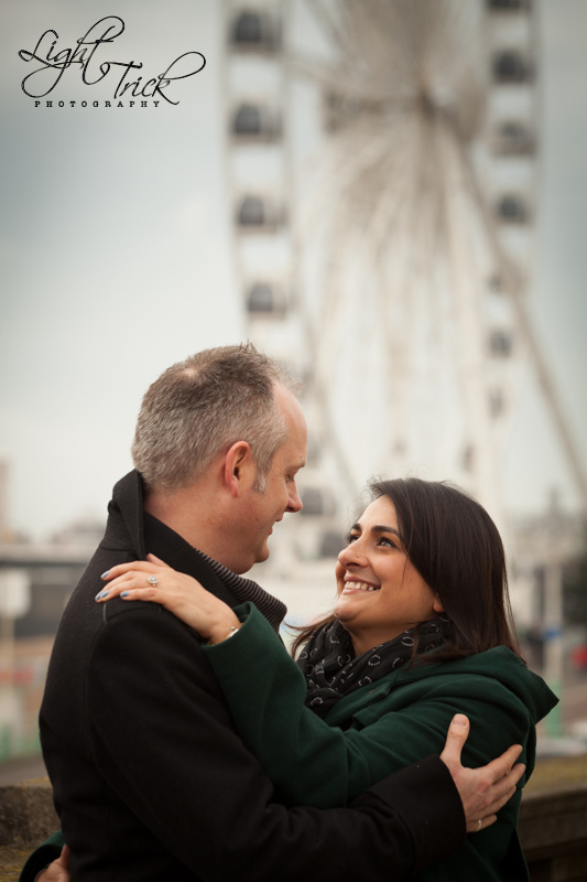 Engaged couple with Brighton Wheel in the background