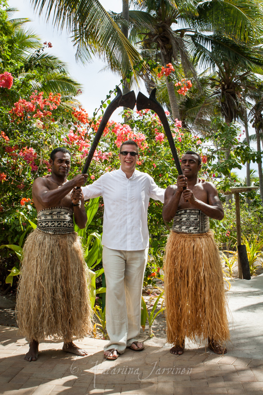 sussex wedding photographer in fiji - groom with fiji warriors