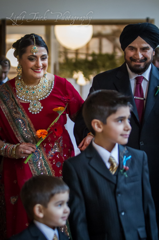 Indian bride arriving with father