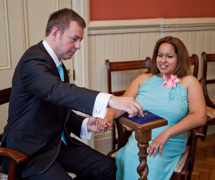 wedding couple exchanging rings at Brighton Town Hall