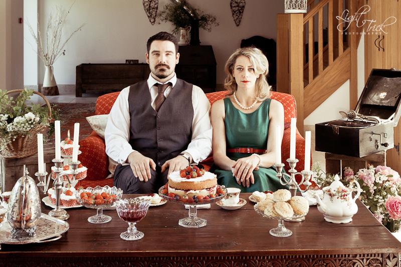 vintage engagement, couple sitting on sofa