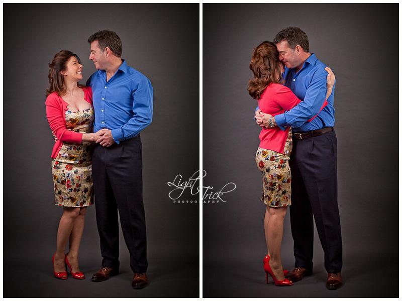 parents hugging in a studio portrait in Hove