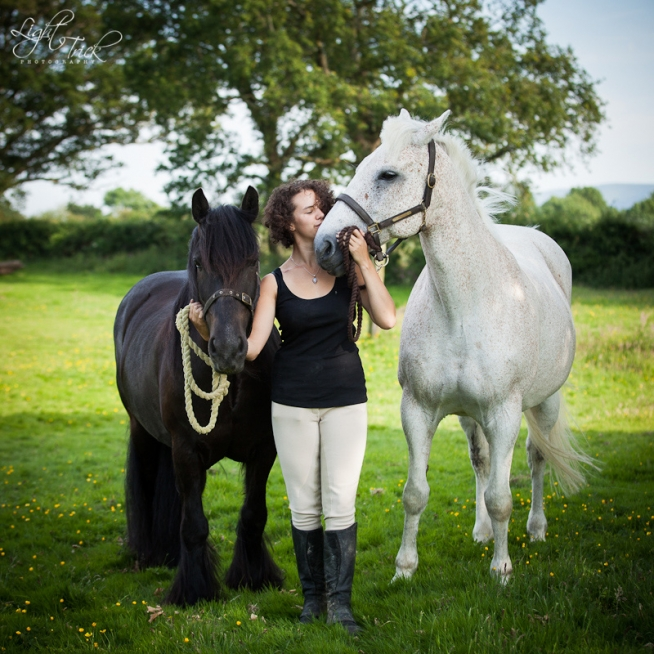portrait of a beautiful woman with two horses