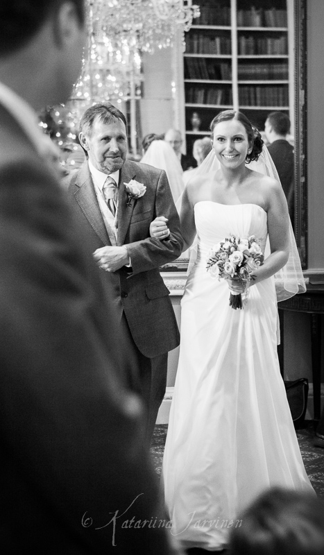 Groom seeing his bride for the first time - happy bride walking down the aisle