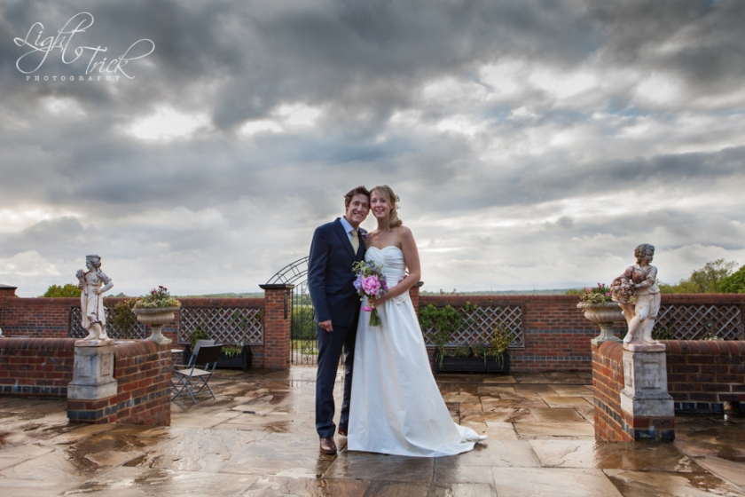 wedding couple portrait on a rainy day with dramatic clouds