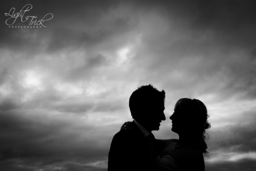 black and white wedding couple silhouette - dramatic sky
