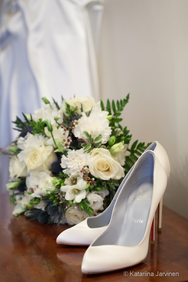 Louboutin white wedding shoes with bouquet