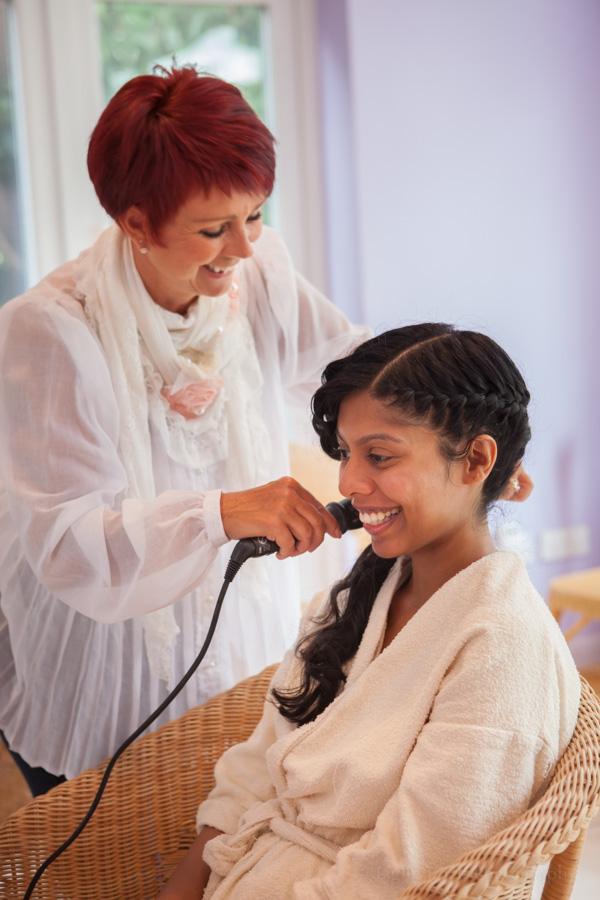 Sri Lankan bride having her hair done
