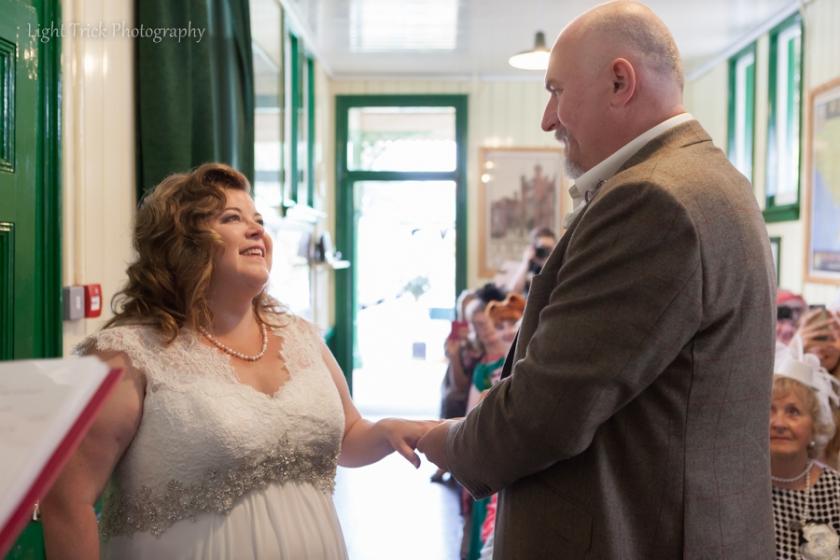 happy couple exchange rings in waiting room