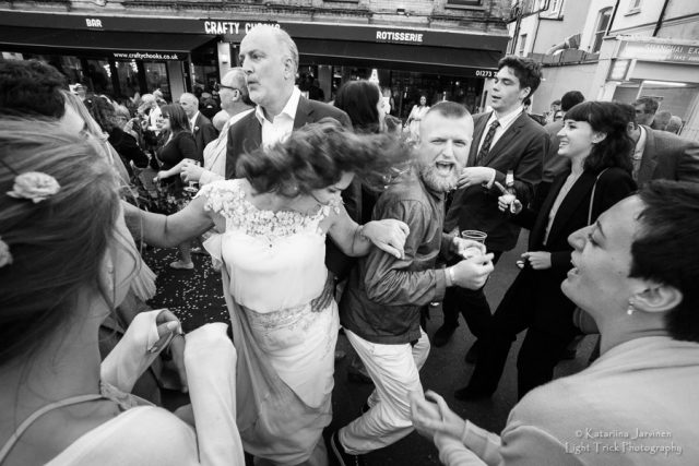 bride dancing at street party wedding